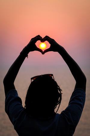 Heart, hands, sunset and silhouette Gokarna (Karnataka, India)