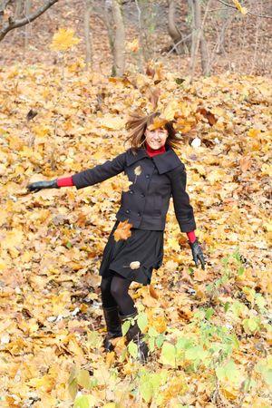 Young female i autumn leaves photo