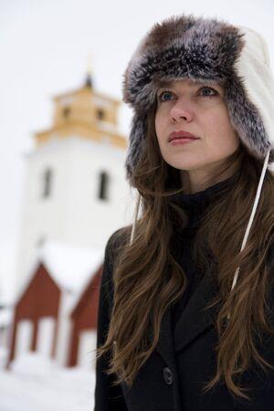 Winter portrait of young beautiful woman photo