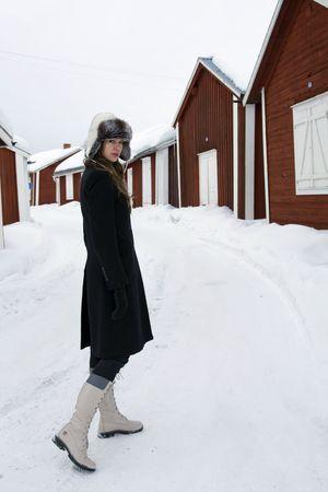 Young beautiful woman walking in snow photo