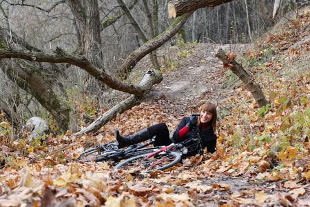 Young female bicycle rider down smiling photo
