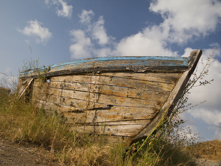 Old nautical vessel - abandoned on the dry land photo