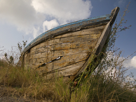 Old nautical vessel - abandoned on the dry land Stock Photo - 24900827