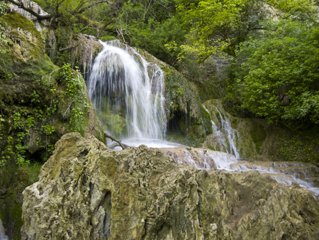 Waterfall near the beautiful village Krushuna in Bulgaria photo