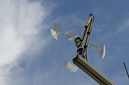 meteorological: Anemometer and wind vane on blue sky
