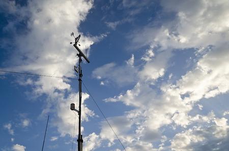 wind vane: Anemometer and wind vane on blue sky