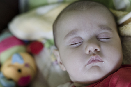 midday: Calm sleeping baby at midday Stock Photo