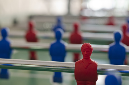 foosball: Players of the game of Foosball in red and blue color