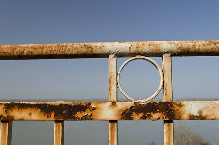Old rusty fence with a depth of field