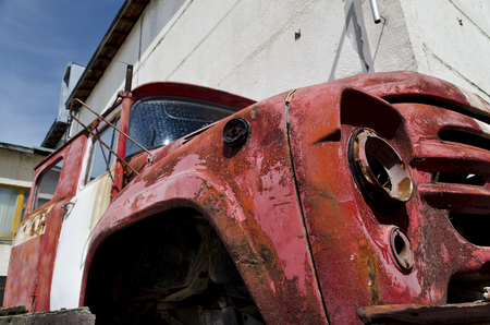 discolored: Old dilapidated truck in the back yard Stock Photo