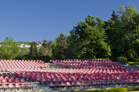 high section: Empty red seats in an open space Stock Photo