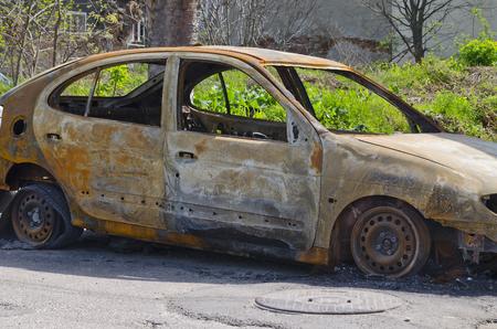 Burned car parked on the street side view - Close up photo of a burned out car Reklamní fotografie