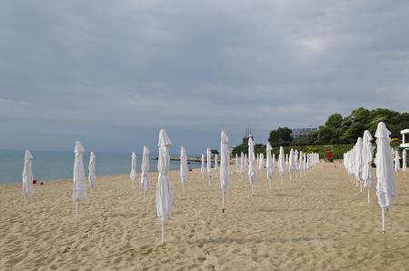 Summer vacation on bulgarian sea - umbrellas on the beach Stock Photo
