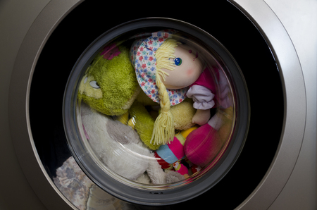 Washing machine door with rotating toys inside