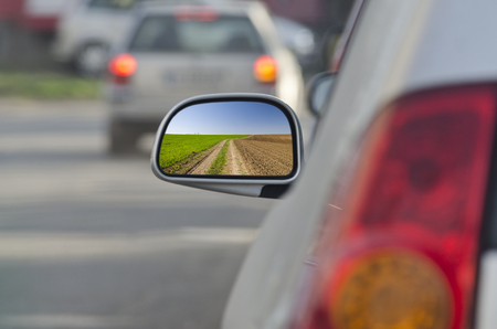 Looking in the side rear-view mirror during the traffic jam