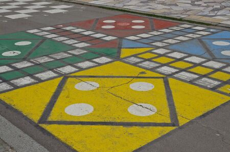 Hopscotch court with numbers from 1 to 9 drawn with paint on the asphalt
