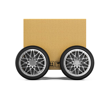 carton: Caja de cartón sobre ruedas Foto de archivo