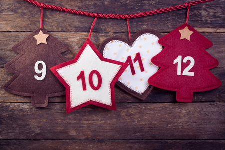 24 month old: Advent calendar on an old wooden background. Toned