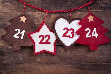 24 month old: Advent calendar on an old wooden background