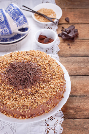 chocolate birthday cake: Chocolate truffle cake with сrushed peanuts and cacao on a wooden background. Selective focus