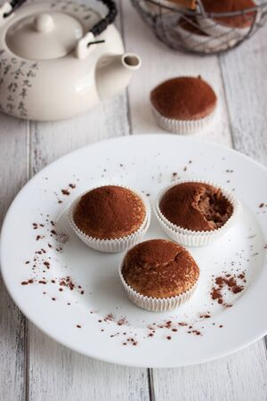 choco chips: Muffins with spelt flour and cocoa in a wooden box on a table, closeup