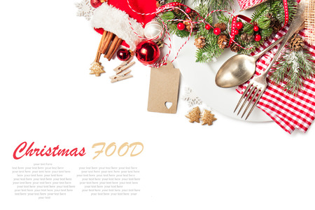 Christmas food concept - plate with fork and spoon with christmas decoration, top view, isolated with sample text Stockfoto