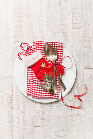 vintage cutlery: Silver vintage cutlery on a plate with christmas decoration and snow on a background, top view