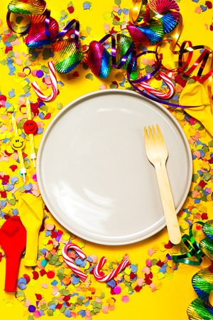 fasching: Party or Carnival background or Party concept with fun articles and party accessories, empty plate above. Top view.