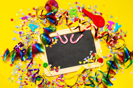 fasching: Happy Birthday, Party or Carnival background or Party concept with fun articles and party accessories, Chalkboard with empty space, view from above. Top view.
