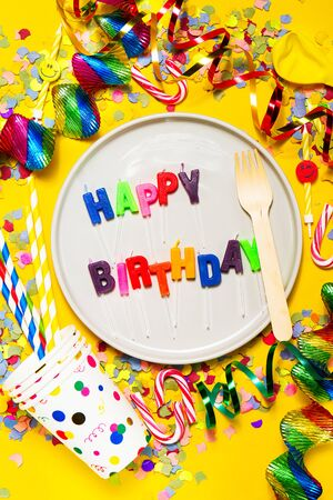 fasching: Happy Birthday, Party or Carnival background or Party concept with fun articles and party accessories, plate with Candles, view from above. Top view.  Stock Photo