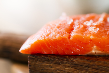 Tasty Fresh Salmon Fish on a Cooking Board on a Kitchen Background. Horizontal with Copy Space.
