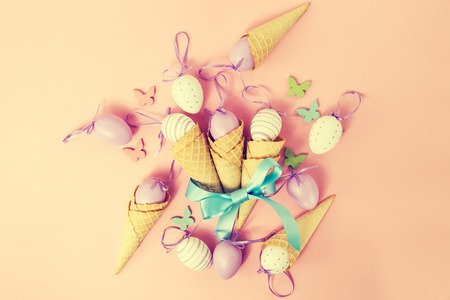 Easter Spring Concept. Flat Lay or Top View of Easter Eggs and Ice Cream Cones. Pastel.