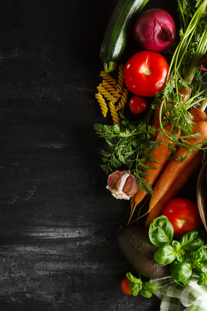 Cooking Healthy Vegetable Detox Concept with Various Vegetables, Cooking Pot on Kitchen Table, Kitchen Background. Top View with Copy Space.
