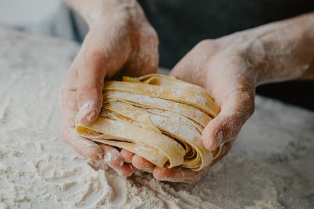 Closeup of process of making cooking homemade pasta. Chef make fresh italian traditional pasta Stok Fotoğraf