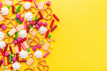 Flat Lay of Tasty Colorful Sweets on Yellow Background. Party Happy Birthday Concept. Sweet Background