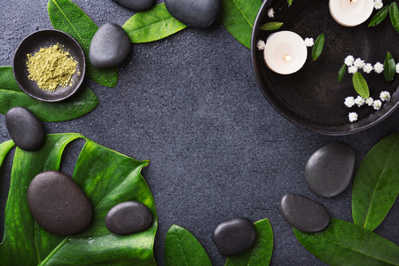 Spa Wellness Relax concept. Spa background with spa accessories on dark background. View from above with copy space.
