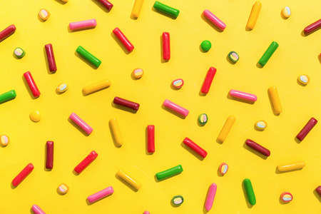 Flat Lay of Tasty Colorful Sweets on Yellow Background. Party Happy Birthday Concept. Sweet Pattern Standard-Bild - 114631440