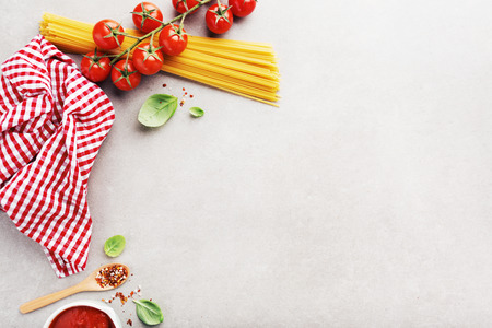 Italian food background. Typical italian food on grey background. View from above with copy space. Standard-Bild - 114631452