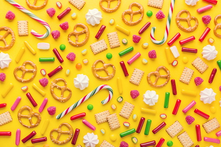 Flat Lay of Tasty Colorful Sweets on Yellow Background. Party Happy Birthday Concept. Sweet Pattern Standard-Bild - 114631461