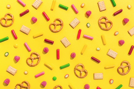 Flat Lay of Tasty Colorful Sweets on Yellow Background. Party Happy Birthday Concept. Sweet Pattern Standard-Bild - 114631618