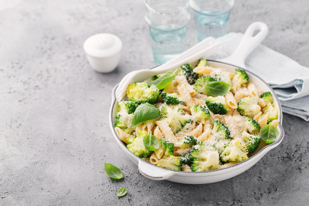 Tasty fresh pasta made with broccoli, basil and cheese served in pan. Concept of healthy food