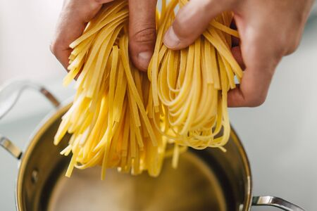 Closeup of cooking tasty fresh pasta. Lifestyle. Cooking concept.