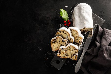 Christmas german stollen sliced on table. View from above