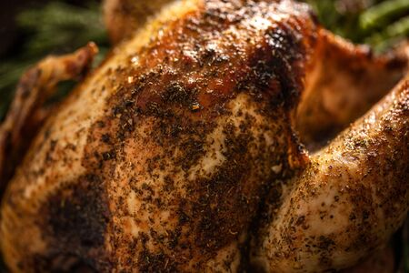 Closeup of tasty baked poultry turkey with rosemary. Thanksgiving or Christmas food.