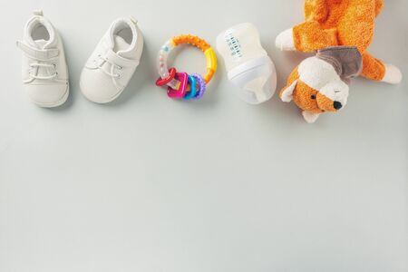 Baby care or baby shower concept. Flat Lay. Newborn or baby cloth, toys, nipple and bottle for feeding.