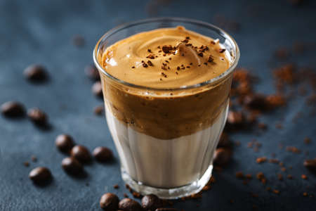 Trendy coffee drink Dalgona with milk and whipped foam made from instant coffee and sugar. Standard-Bild