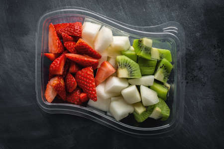 Lunch to go with fruits in box. View from above.