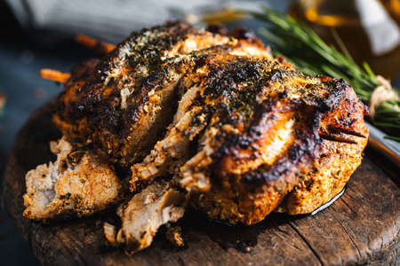 Tasty appetizing baked pork with spices and herbs. Closeup.