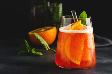 Tasty sweet freshmade refreshing summer cocktail with oranges and mint served in glass. Closeup