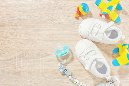 Baby accessories for healthcare, playing and feeding on table. Flat lay. Baby or children concept. Reklamní fotografie